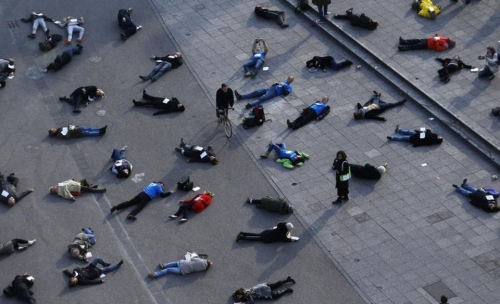 631191-people-lay-down-in-a-pedestrian-zone-as-part-of-an-art-project-in-remembrance-of-528-victims-of-the-.jpg