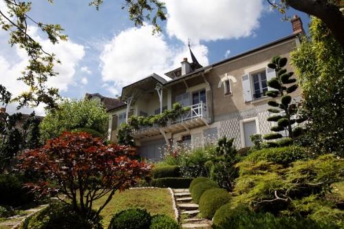 Maison-Maurice-Ravel-Facade-et-jardin-750x500.jpg